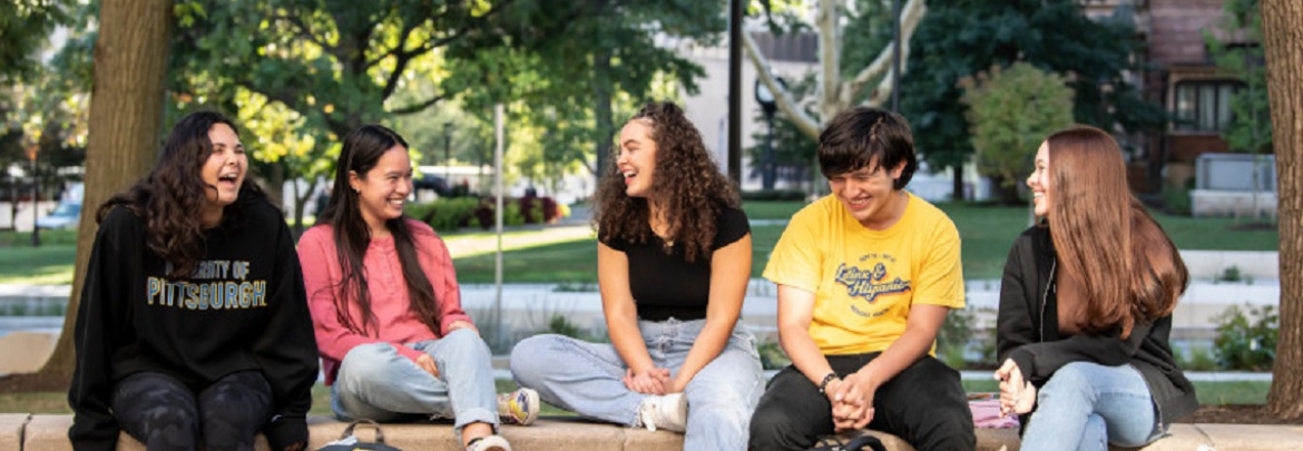 Students talking and laughing on campus